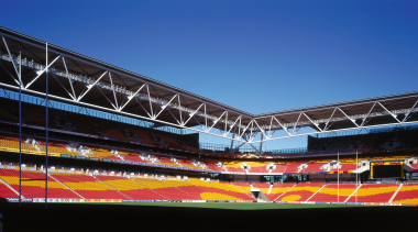 View of the stadium's seating - View of architecture, arena, atmosphere, landmark, metropolitan area, sky, soccer specific stadium, sport venue, stadium, structure, black, blue
