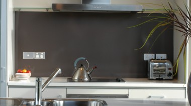 Kitchen with light grey cabinetry, white benchtop, and countertop, furniture, kitchen, black, gray