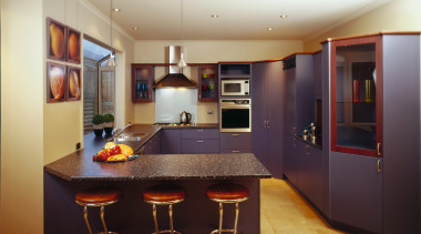Kitchen with blue purple coloured doors in tongue cabinetry, countertop, interior design, kitchen, real estate, room, black, orange