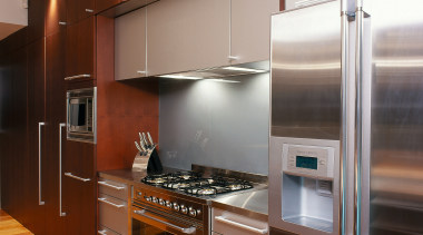 view of the oven, refrigerator, microwave and cabinetry cabinetry, countertop, cuisine classique, hardwood, home appliance, interior design, kitchen, room, under cabinet lighting, brown