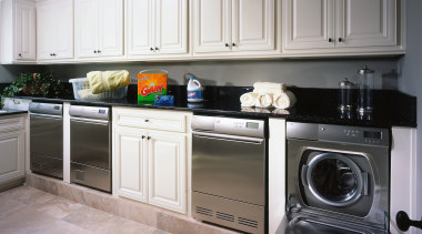 View of the laundry of this home - cabinetry, countertop, cuisine classique, home appliance, kitchen, kitchen appliance, kitchen stove, laundry room, major appliance, room, washing machine, gray