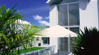 Two storey white house with outdoor table and apartment, architecture, arecales, building, condominium, estate, facade, home, house, palm tree, property, real estate, residential area, swimming pool, villa, window, blue