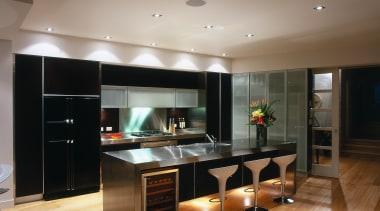 interior view showing cooling storage cabinets - interior cabinetry, countertop, floor, flooring, hardwood, interior design, kitchen, laminate flooring, living room, room, wood flooring, brown