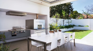This outdoor kitchen is well equipped for entertaining architecture, daylighting, house, interior design, real estate, roof, table, white
