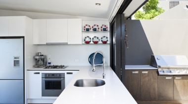 This crisp white kitchen features Fisher & Paykel countertop, interior design, kitchen, product design, white