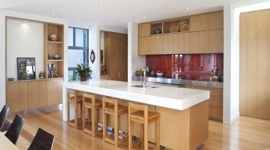 View of kitchen with wooden flooring, white bench cabinetry, countertop, floor, flooring, hardwood, interior design, kitchen, real estate, room, wood, wood flooring, white, orange