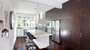 A view of kitchen cabinetry by Cabinetmakers. - cabinetry, countertop, cuisine classique, interior design, kitchen, real estate, room, white, red, gray
