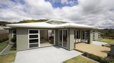 This Tauranga show home has several features with elevation, estate, facade, home, house, property, real estate, residential area, roof, gray