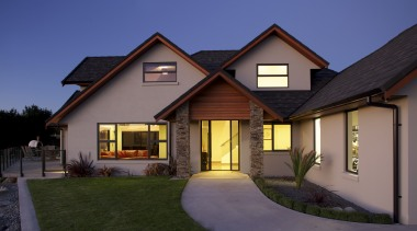Design and build by Fowler Homes Taranaki - building, cottage, elevation, estate, facade, home, house, lighting, property, real estate, residential area, roof, siding, sky, window, blue