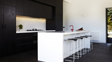 A crisp, monochromatic palette defines this new beach architecture, countertop, floor, flooring, furniture, house, interior design, kitchen, table, black, white