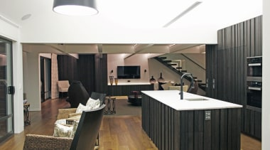 White marble contrasts the dark timber on the countertop, interior design, kitchen, white, black