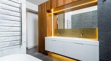 The white floating vanity is underlit, adding to architecture, bathroom, interior design, room, wall, white