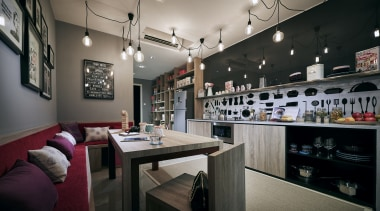 At the opposite end of the open-plan living interior design, black, gray