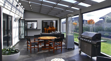 An all-weather outdoor space is the social hub interior design, outdoor structure, patio, real estate, gray, black