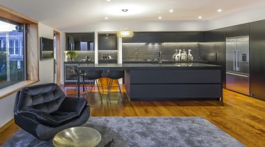 This clean-lined kitchen merges with the wider environment interior design, kitchen, living room, real estate, room, gray, black