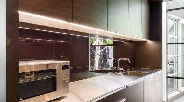 Clean surfaces and understated handles in this butlers cabinetry, countertop, furniture, interior design, kitchen, black