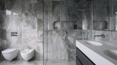 A floating vanity, toilet and bidet are teamed architecture, bathroom, black and white, floor, flooring, interior design, plumbing fixture, room, tap, tile, wall, gray, black