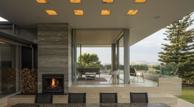 As a playful addition to this home, the architecture, ceiling, house, interior design, living room, lobby, patio, real estate, table, brown, black