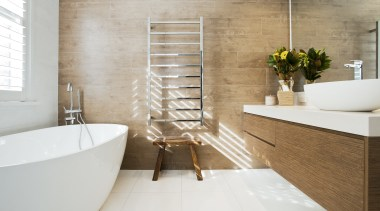 Sunlight, filtered through timber privacy shutters, lights up bathroom, ceramic, floor, flooring, home, interior design, plumbing fixture, product design, room, sink, tap, tile, wall, wood, white