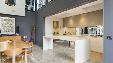 A mirror splashback and island front extends the architecture, countertop, interior design, kitchen, real estate, gray