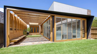 On this extension by CplusC Architectural Workshop, a architecture, backyard, estate, facade, grass, home, house, property, real estate, residential area, siding, window, wood