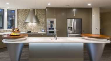 Well-rounded design – an adjacent conical tower roof countertop, floor, interior design, kitchen, room, sink, gray