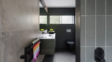 This private master ensuite addition is finished in architecture, bathroom, bathroom accessory, floor, interior design, product design, room, tile, gray, black