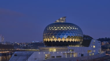 The glass-clad Auditorium is the crowning glory on architecture, building, city, dawn, daytime, dusk, evening, horizon, landmark, night, reflection, river, sky, structure, tourist attraction, water, water resources, waterway, blue