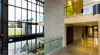 Window systems in the new ACG Gymnasium operate architecture, condominium, glass, interior design, lobby, real estate, white