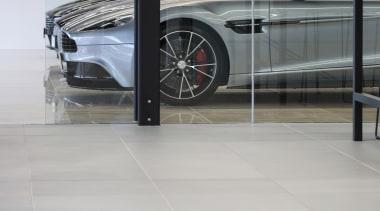 The new Giltrap building features large-format concrete pavers automotive design, automotive exterior, automotive wheel system, car, executive car, floor, flooring, luxury vehicle, motor vehicle, personal luxury car, vehicle, vehicle door, wheel, gray