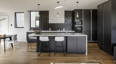 Dark cabinetry surfaces in this kitchen work well countertop, floor, flooring, interior design, kitchen, room, gray, black