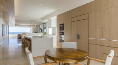 In this new coastal home by Craig Steere ountertop, travertine flooring, , kitchen, timber cabinetry, Craig Steere, American Oak,  Blume, ceasarstone, travertine