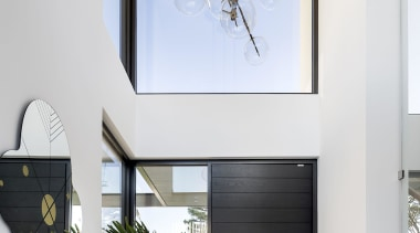 The dramatic double-height entry to the home. A