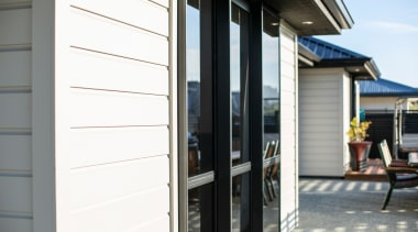 Envira Weatherboards Installed Using Precut Scribers For A door, facade, home, house, real estate, siding, window, white, gray