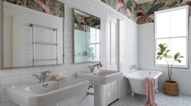 The bathroom strikes a perfect balance between a