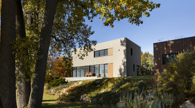Positioned between road and river, the St-Ignace house black, brown