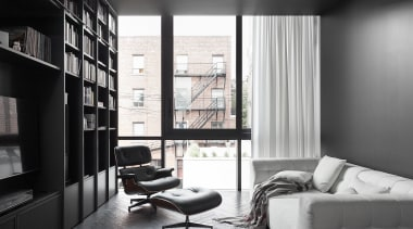 The telltale contemporary tall windows indicate this study