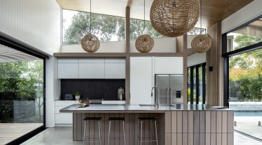 Large sliding doors peel away and the home's