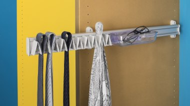 Ambos tie hangers are available in Fixed andPull clothes hanger, yellow, brown, orange