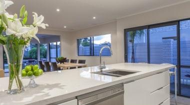 Back-recessed aluminium handle create a no-handle effect ceiling, countertop, interior design, kitchen, real estate, gray