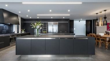 Matt stainless steel toekicks complete this metal-look kitchen gray, black