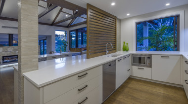Designer Kira Gray designed a combined public kitchen architecture, building, cabinetry, ceiling, countertop, design, estate, floor, furniture, hardwood, home, house, interior design, kitchen, lighting, property, real estate, room, wood flooring, gray