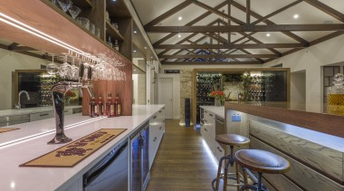 Fyfe Kitchen's singular resort-style kitchen-bar looks equally impressive architecture, beam, building, ceiling, countertop, floor, flooring, furniture, home, house, interior design, kitchen, lighting, loft, property, real estate, room, table, gray, brown