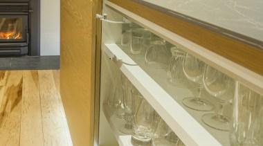 In this ergonomic kitchen, sleek, efficient cabinet door architecture, cabinetry, countertop, floor, flooring, furniture, glass, home, house, interior design, kitchen, marble, material property, property, room, shelf, orange
