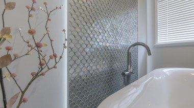 This feature 'Silver Scale' tile wall is further architecture, bathroom, bathroom accessory, curtain, floor, flooring, home, house, interior design, plumbing fixture, property, real estate, room, shower curtain, tap, tile, wall, window treatment, gray