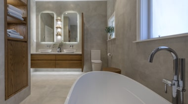 A sculptural tub makes the most of natural architecture, bathroom, bathtub, building, estate, floor, flooring, furniture, home, house, interior design, material property, plumbing fixture, property, real estate, room, sink, tap, tile, wall, gray
