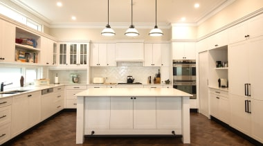 Classic pendants are matched with modern slender countertops building, cabinetry, ceiling, countertop, cuisine classique, cupboard, floor, flooring, furniture, hardwood, home, house, interior design, kitchen, light fixture, lighting, material property, property, real estate, room, sink, tile, wood flooring, orange