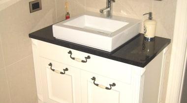Bathroom Vanities - bathroom | bathroom accessory | bathroom, bathroom accessory, bathroom cabinet, bathroom sink, cabinetry, countertop, floor, plumbing fixture, room, sink, tap, orange
