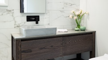 The large, custom-designed vanity includes wide drawers for