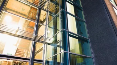 Below left A five-storey glass atrium connects the apartment, architecture, building, commercial building, condominium, daylighting, facade, glass, metropolitan area, mixed use, window, black